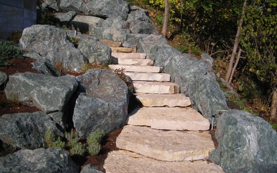 Flat Stone Stairs Leading Up To Patio